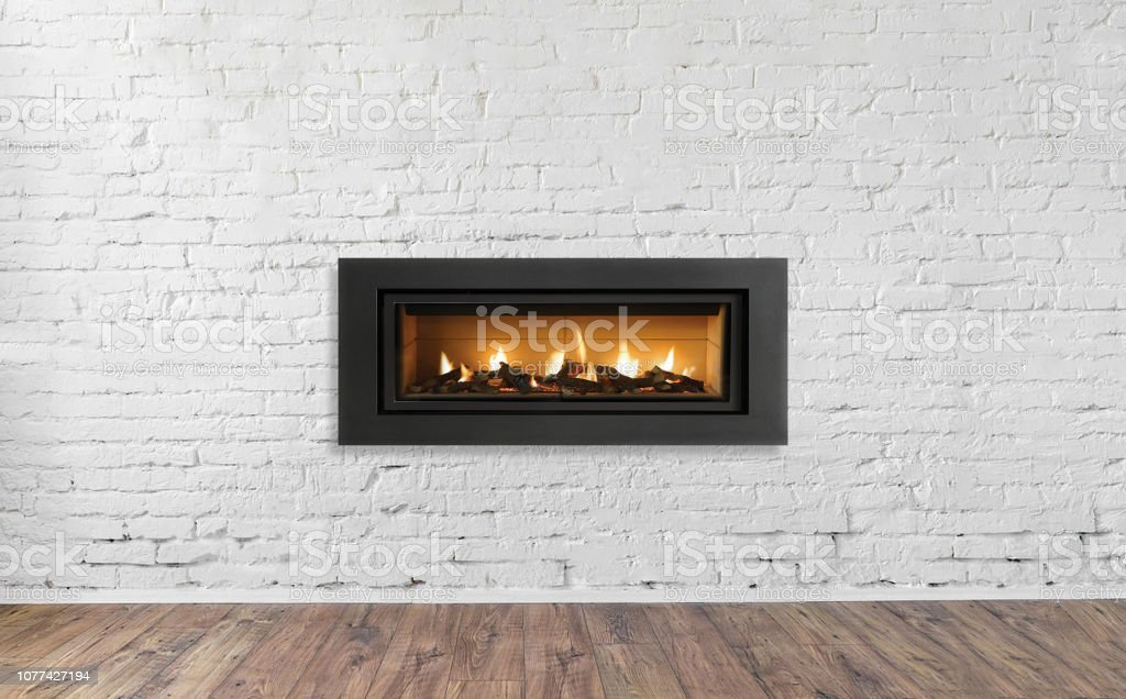 Gas Fireplace On White Brick Wall In Bright Empty Living Room