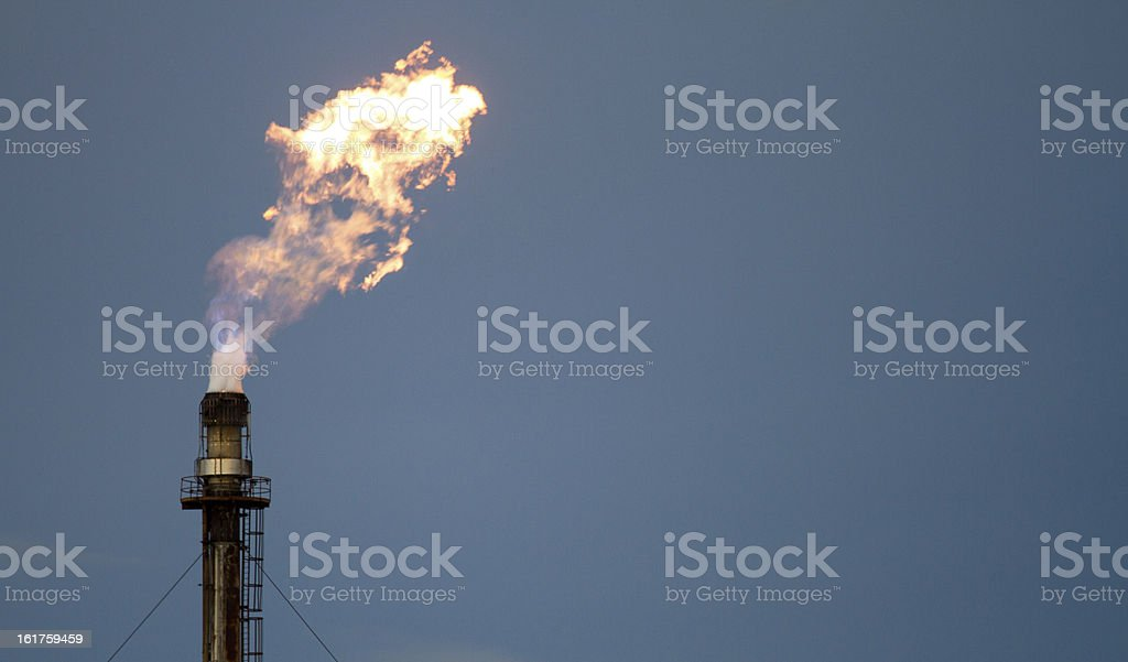 Gas flame from petrochemical works roars stock photo