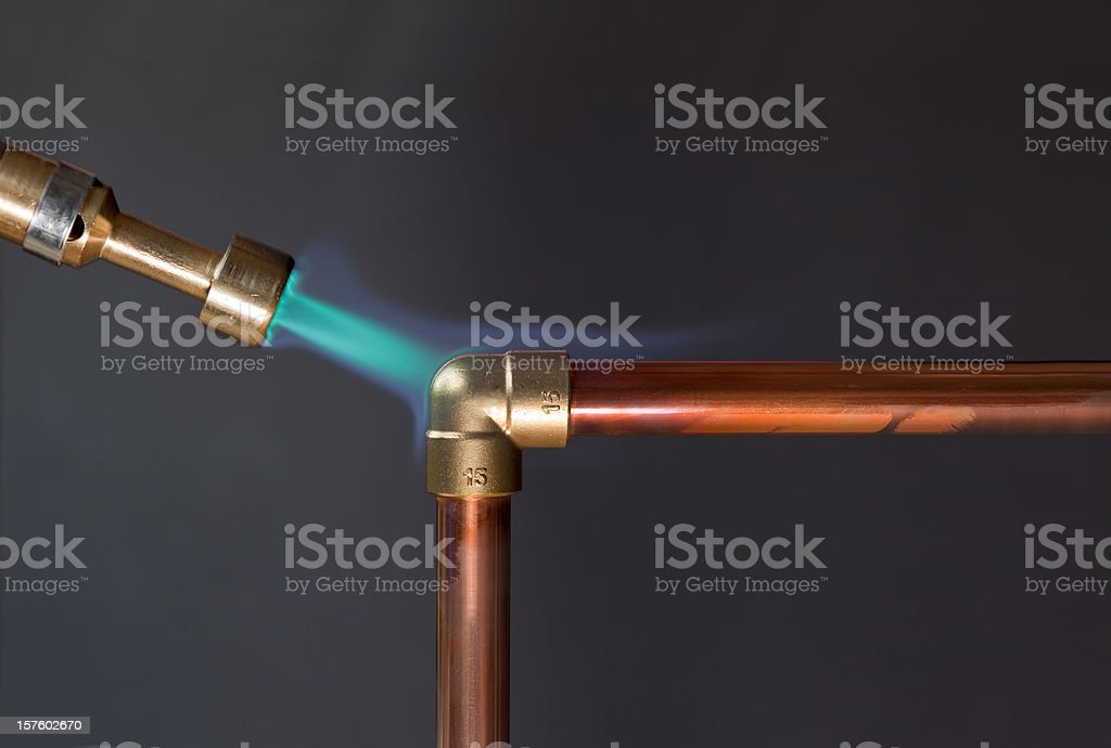 Gas flame heating copper piping foto