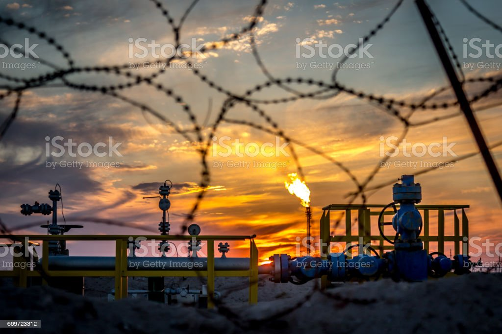 Gas flame torch on a oil refinery plant stock photo