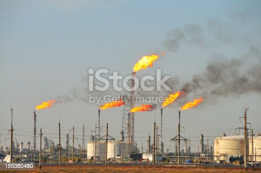 Gas flaring at an oil refinery.
