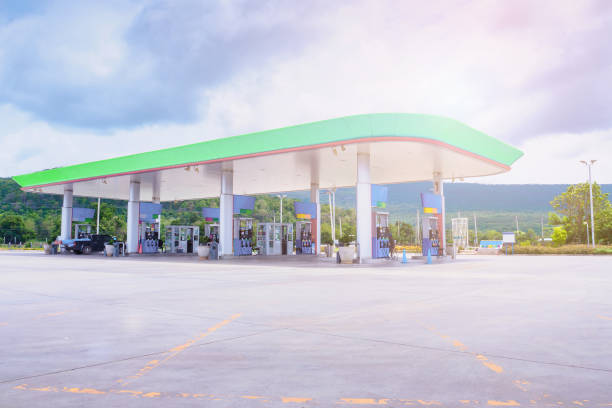 Gas fuel station with clouds in the sky and sun light stock photo