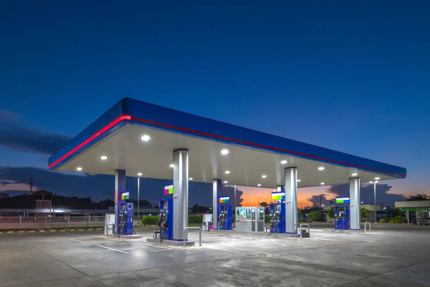 gas fuel station with sunrise sky - station stock pictures, royalty-free photos & images