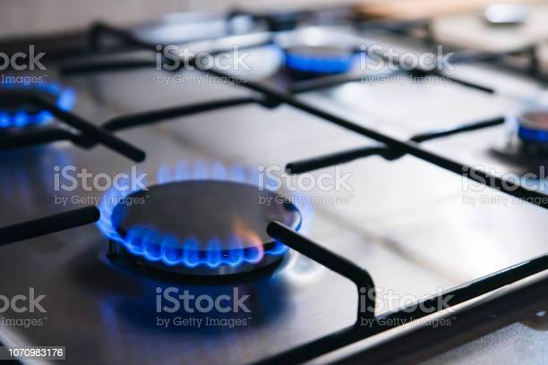 Gas Kitchen Stove Cook With Blue Flames Burning Stock Photo - Download Image Now