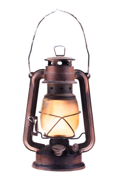 Gas lantern with burning light, isolated on a white background. An antique vintage lamp. Hipster accessory. Camping light. Interior decoration. Oil lamp. Kerosene lantern. Rusty, covered with patina. Metal case, smoked frosted glass. Wire handle up lantern stock pictures, royalty-free photos & images