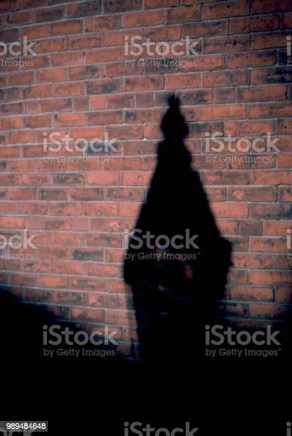 Gas light Shadow on a Brick Wall