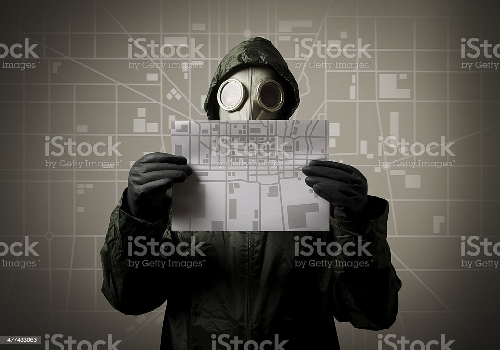 Gas mask and city map. Evacuation concept. stock photo
