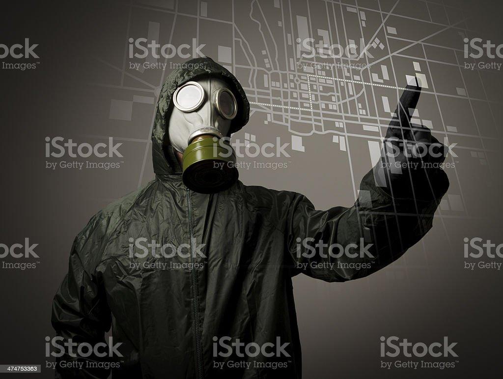 Gas mask and map. Evacuation. stock photo