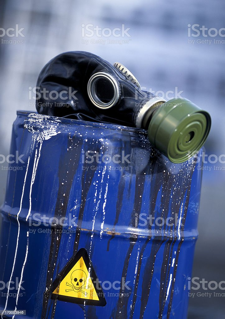 gas mask on leaking barrel with toxic waste royalty-free stock photo