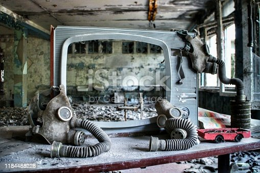 Soviet-era gas masks are hung up on a weathered TV screen in an abandoned building in Pripyat, Ukraine, site of the 1986 Chernobyl nuclear desaster and center the Chernobyl exclusion zone.