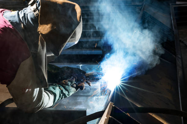 Gas metal arc welding (GMAW, MAG, MIG). MIG welding is a metal shielding gas welding process (GMAW) with inert gas, in which the light arc burns between a continuously fed melting wire electrode. Gas metal arc welding (GMAW, MAG, MIG). MIG welding is a metal shielding gas welding process (GMAW) with inert gas, in which the light arc burns between a continuously fed melting wire electrode. metalwork stock pictures, royalty-free photos & images