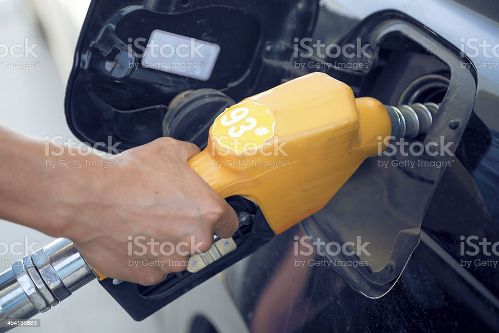 gas nozzle adding 93 number oil royalty-free stock photo