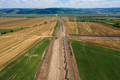 Aerial view of gas pipeline between agriculture fields.