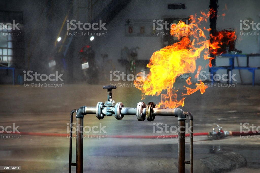 Gas pipeline leaks at the joints with the valve. Spark and Fire on the gas pipeline. An explosion at the gas pipeline. - Royalty-free Accidents and Disasters Stock Photo