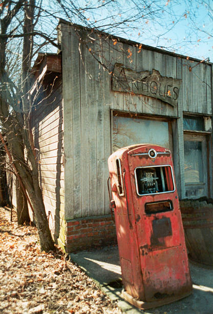 Gas pump and antique shop stock photo
