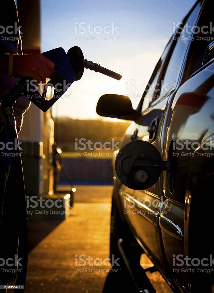 Gas pump filling up a car. stock photo