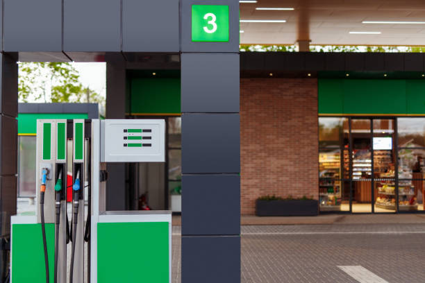 Gas pump near store on filling station stock photo