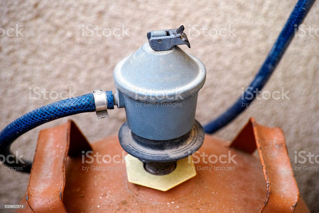 Gas regulator switch on gas bottle stock photo