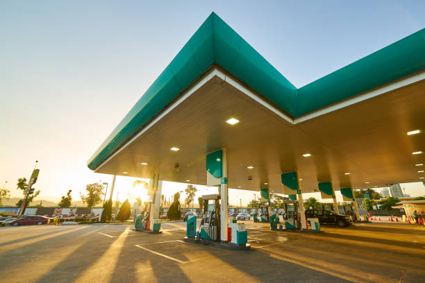gas station at sunrise morning . - station stock pictures, royalty-free photos & images