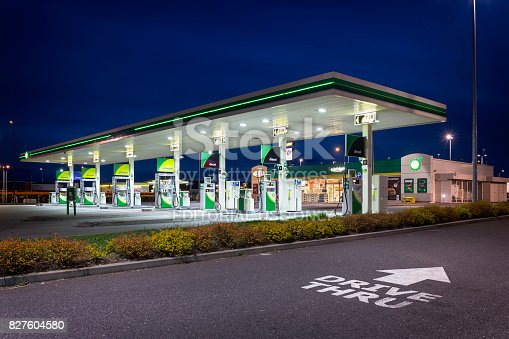 Szczecin, Poland - April 11,2017:BP gas station by night. BP gas stations and products including gasoline, diesel, motor oil, Szczecin, Poland