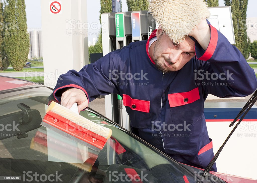 Gas Station Cleaning Windshield royalty-free stock photo