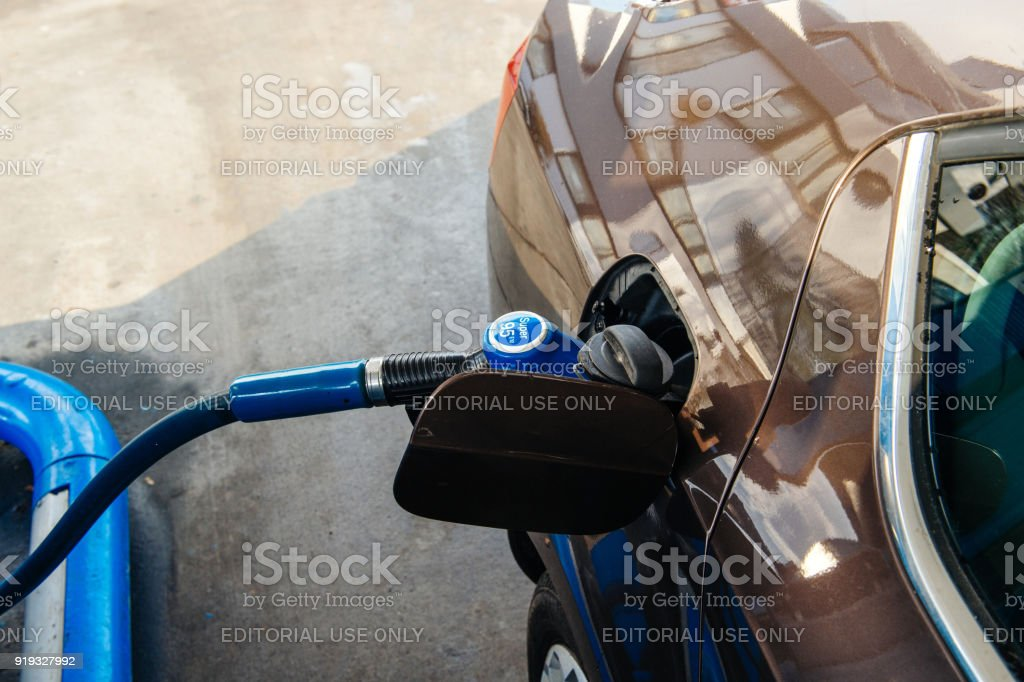 Gas station filling tank with petrol gasoline fuel stock photo