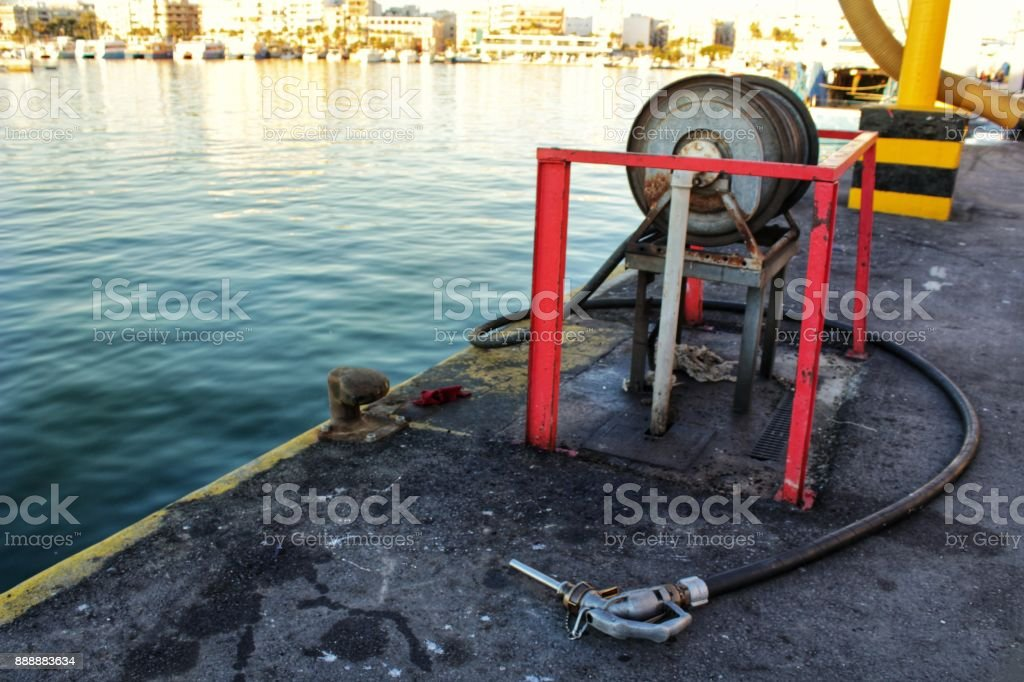 Gas station for fishing boats in the port stock photo