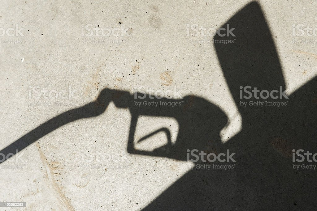 Gas Station Pump Shadow Fueling Car Tank For Road Trip royalty-free stock photo