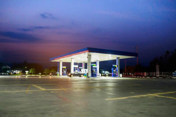 gas station with clouds and sky at sunset - dworzec zdjęcia i obrazy z banku zdjęć