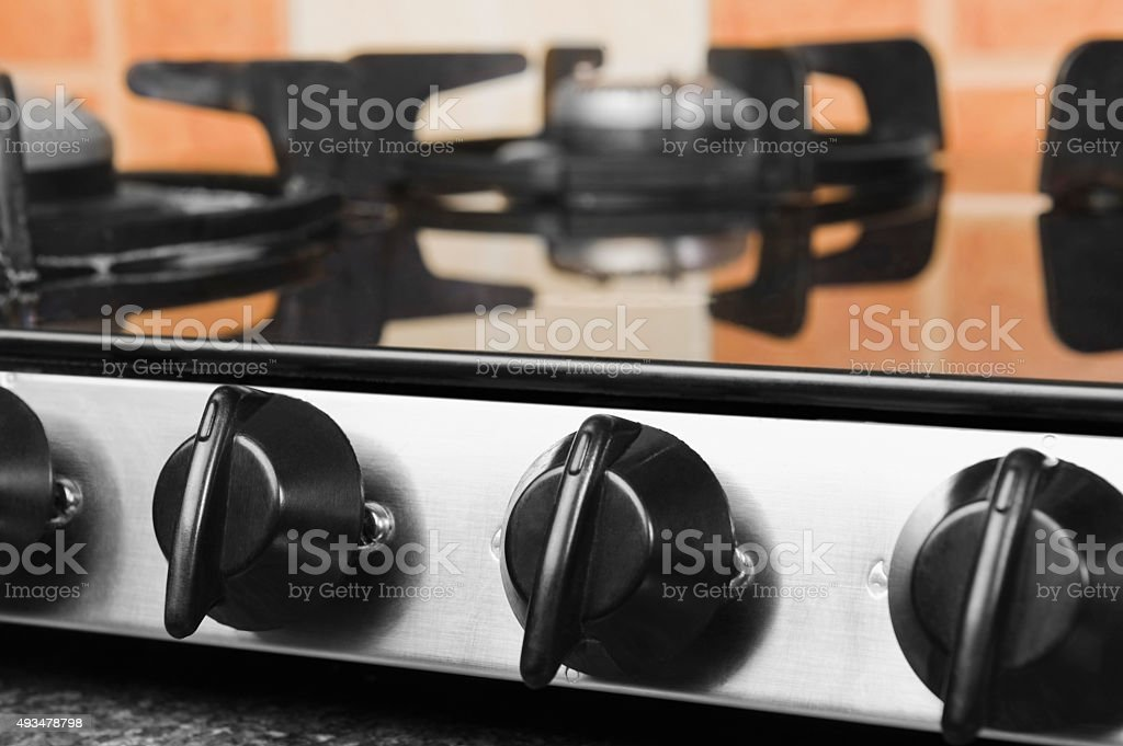 Gas stove on a kitchen counter stock photo