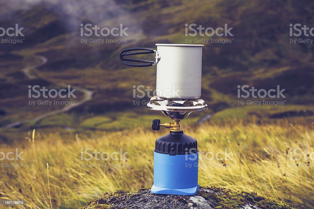 Gas stove with pot of boiling water in the mountains royalty-free stock photo