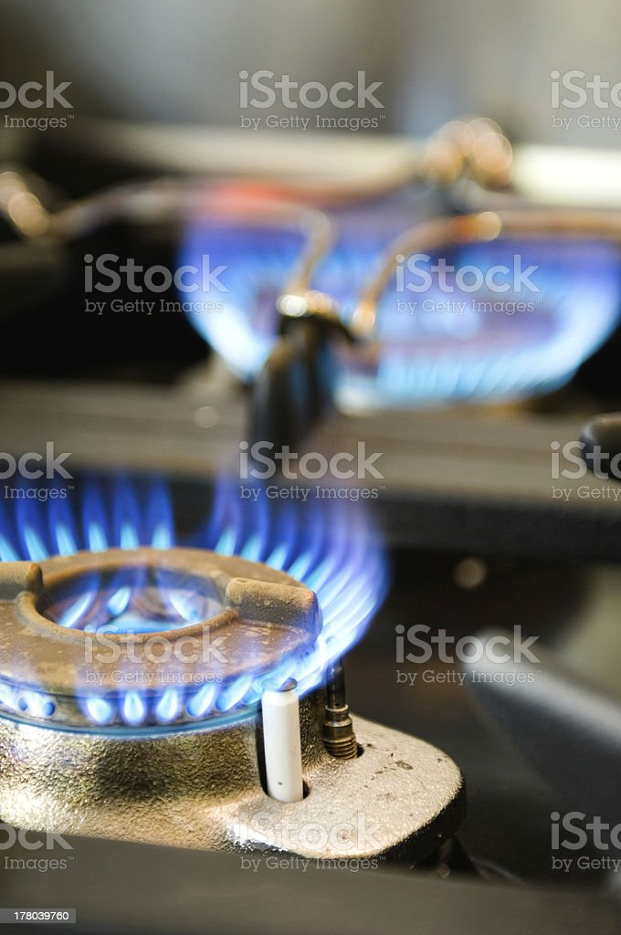 Gas stove with two burning blue flames royalty-free stock photo