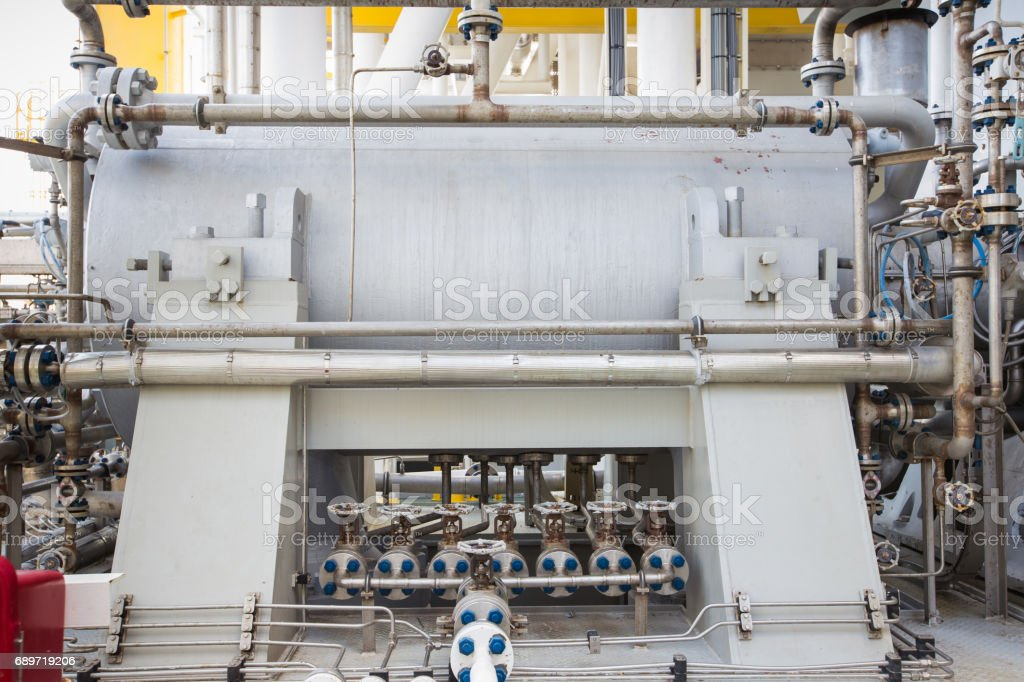 Gas turbine compressor bundle for compress gas to high pressure for sent gas to onshore refinery plant stock photo