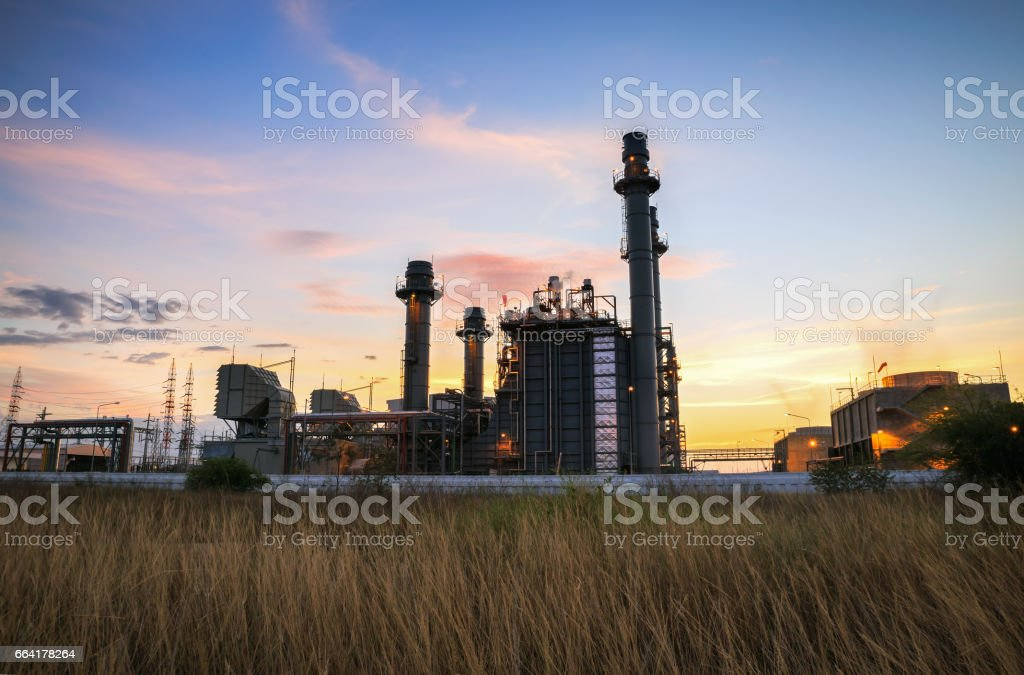 Gas turbine electric power plant with sunset stock photo