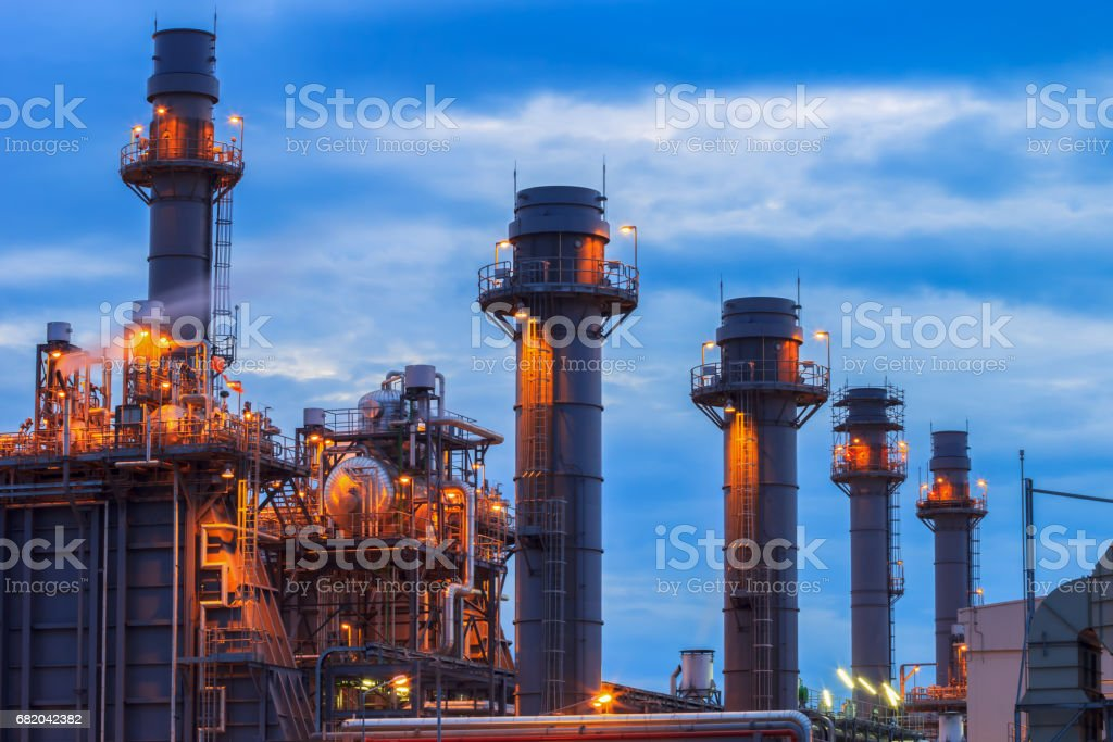 Gas turbine electrical power plant at dusk with raining sky stock photo