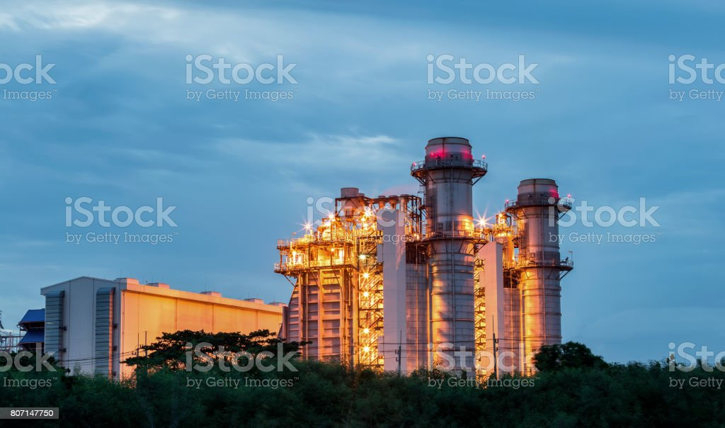 Gas turbine electrical power plant at dusk with sunset stock photo