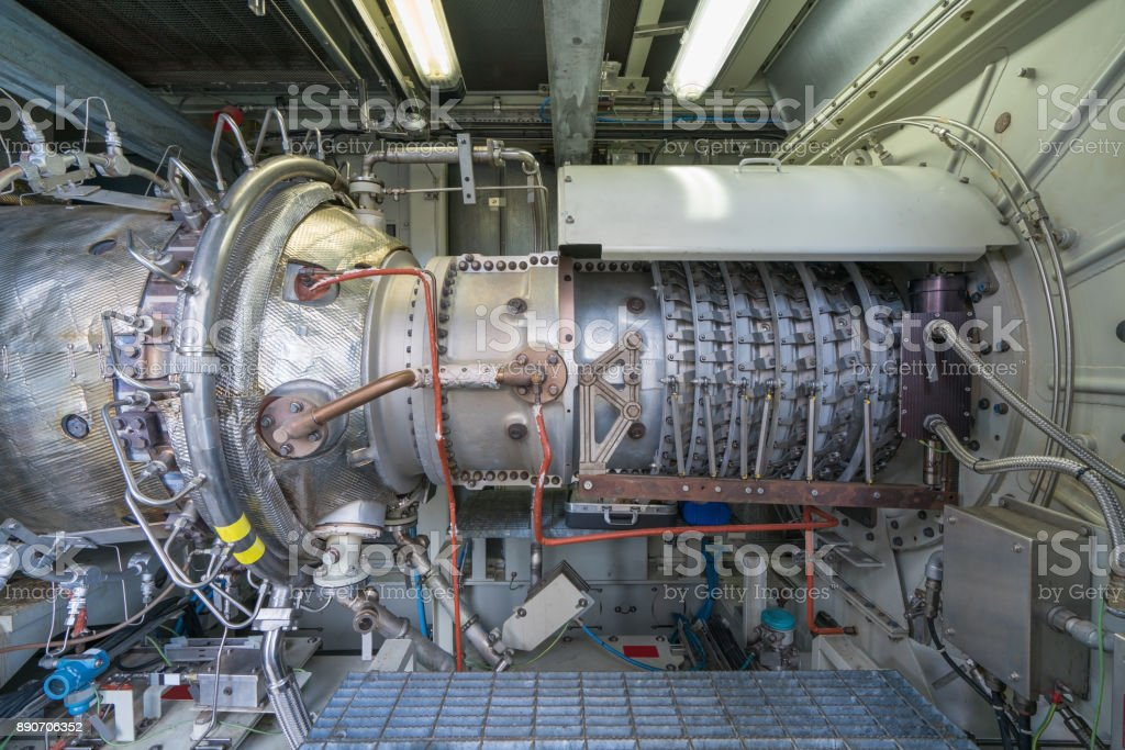 Gas turbine engine centrifugal type of sales gases compressor in pressurized enclosure there are inlet combustion chamber and exhaust in package. stock photo