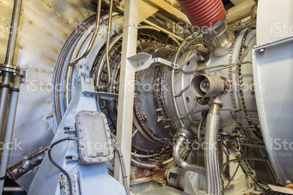 Gas turbine engine of feed gas compressor located inside pressurized enclosure, The gas turbine engine used in offshore oil and gas central processing platform. stock photo