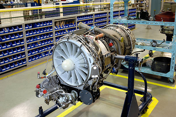 Gas turbine (jet) engine on stand for overhaul stock photo