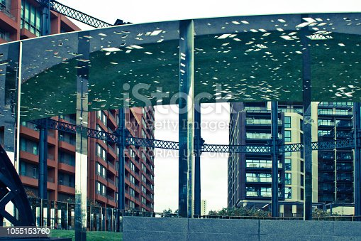 Mirrored uprights in a regenerated old gas holder in Kings Cross area of North London.