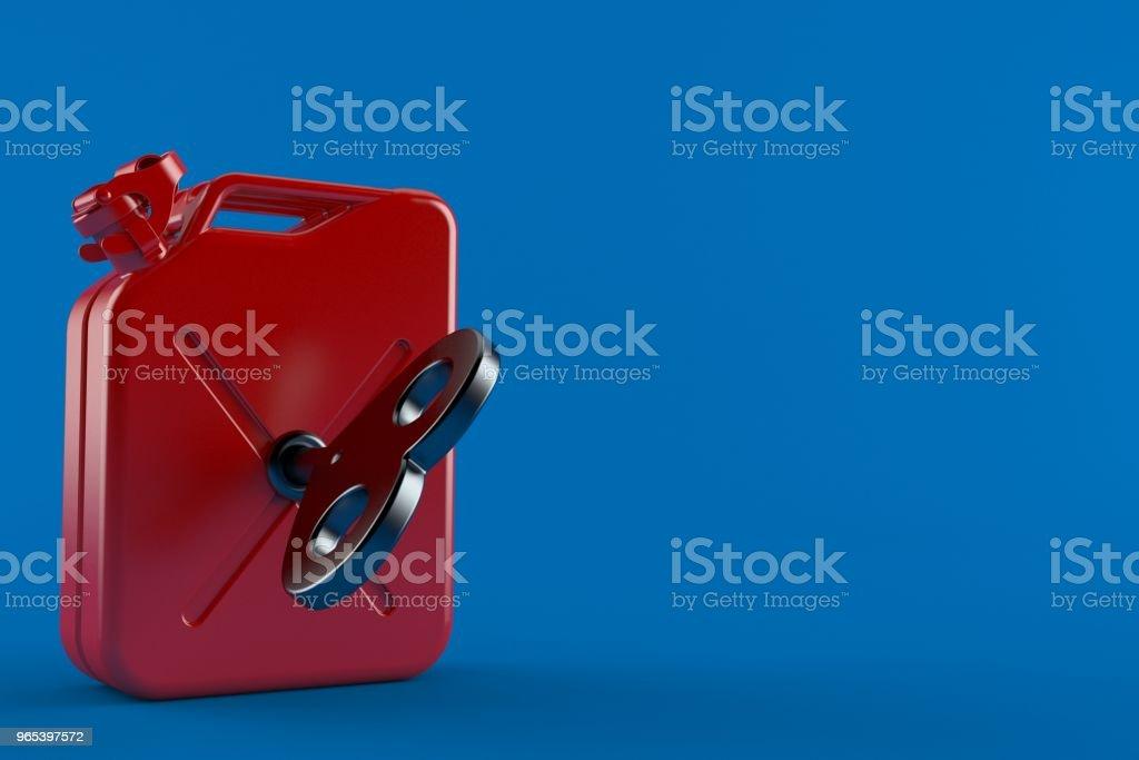 Benzin-Kanister mit Uhrwerk Schlüssel - Lizenzfrei Behälter Stock-Foto