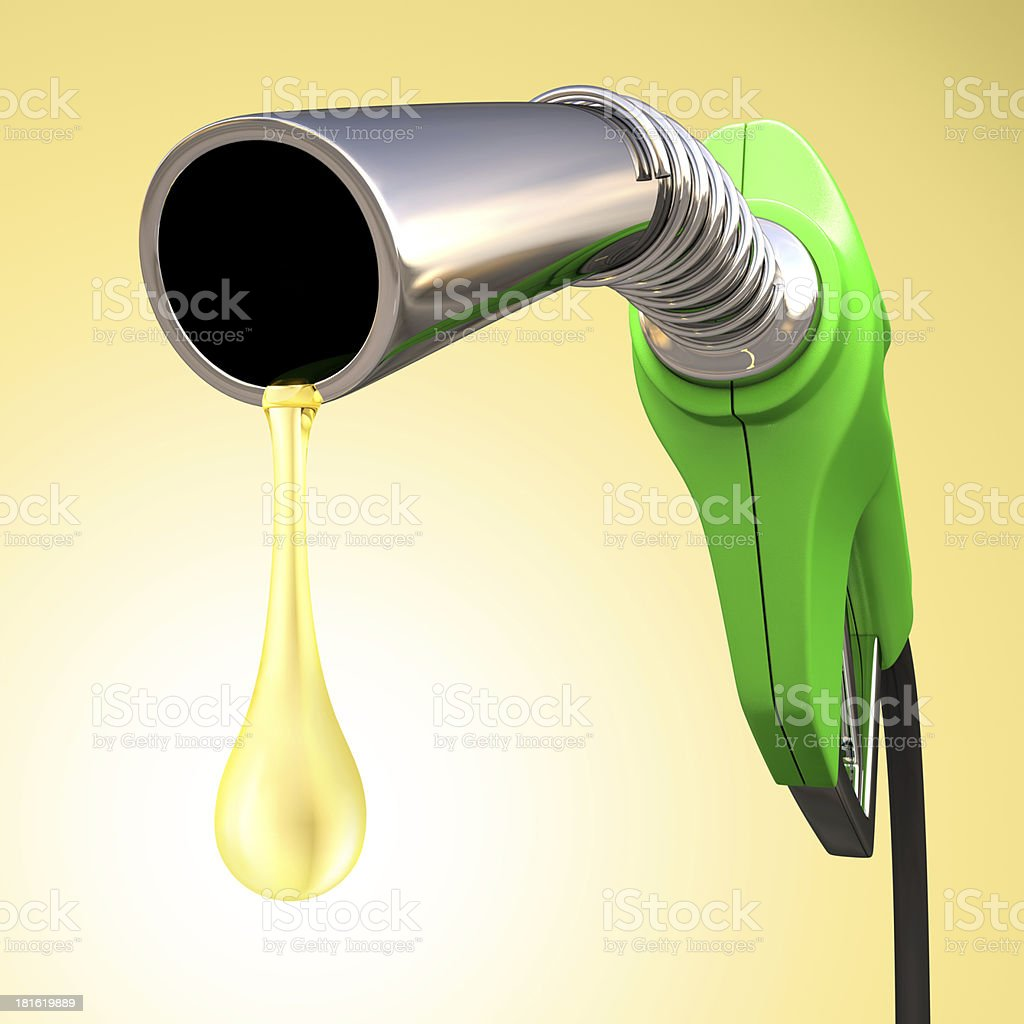 A gasoline pump dripping gas on a yellow background stock photo
