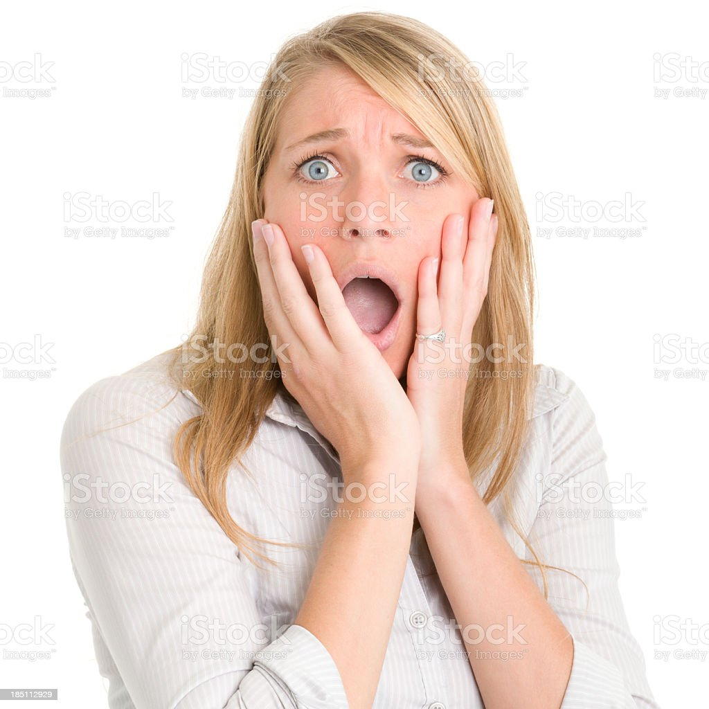 Gasping Shocked Woman With Hands On Cheeks royalty-free stock photo