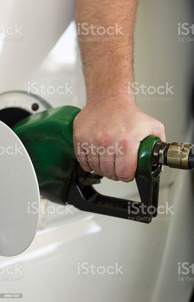 Gassing up (vertical) royalty-free stock photo