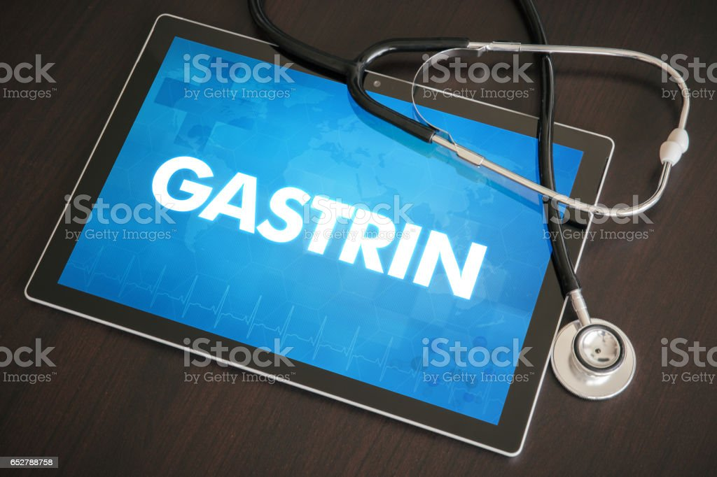 Gastrin (gastrointestinal disease related) diagnosis medical concept on tablet screen with stethoscope stock photo