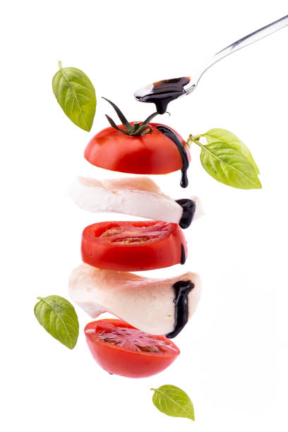 gastronomic caprese salad with mozzarella and tomato succulent caprese salad with mozzarella cheese and tomato topped with a glaze of balsamic vinegar balsamic vinegar stock pictures, royalty-free photos & images