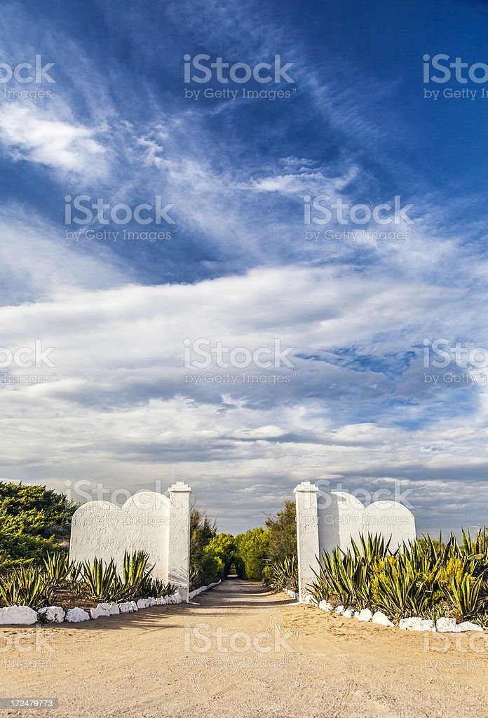 Gate and driveway of a property royalty-free stock photo