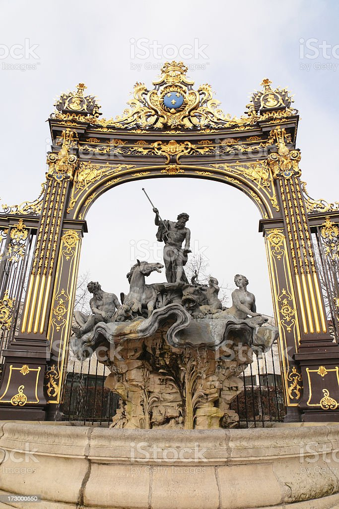 gate and well on Place Stanislaus in Nancy (France) royalty-free stock photo