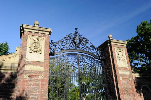 gate at harvard yard - harvard university stock photos and pictures