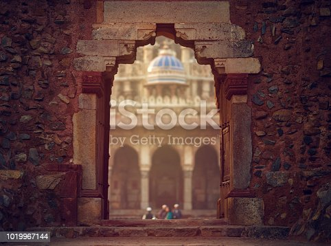 horizontal shot of gate in old temple in India.